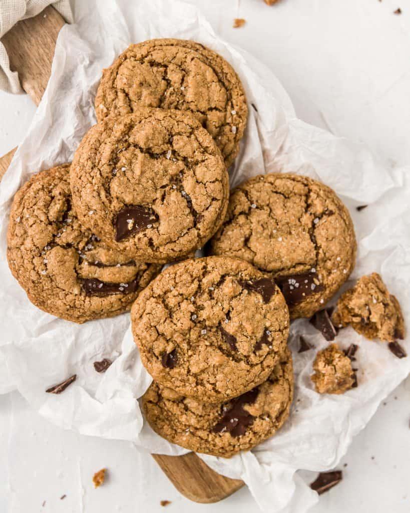Vegan and gluten-free chocolate chunk cookies on a cutting board